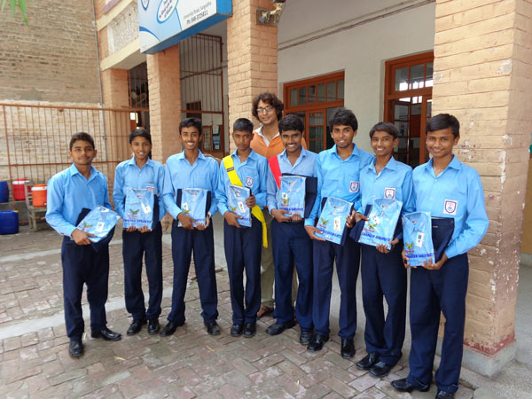 The students of St. Peter Boys High School of Sargodha receive new uniforms to reward their commitment